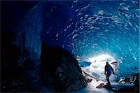 Hiker Mendenhall Glacier Exploring Ice Cave AK Southeast                                                                                                                                                 Stock Photo - Premium Rights-Managednull, Code: 854-02956117