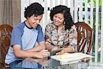 Mother Teaching Her Son How to Manage His Finances Stock Photo - Premium Rights-Managed, Artist: Kevin Dodge              , Code: 700-02957641
