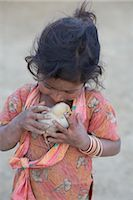 Little Girl Holding Chick, Chapagaon, Nepal Stock Photo - Premium Rights-Managednull, Code: 700-02957845