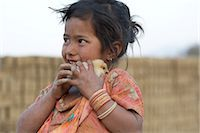 Little Girl Holding Chick, Chapagaon, Nepal                                                                                                                                                              Stock Photo - Premium Rights-Managednull, Code: 700-02957846