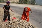 Women Shoveling Rocks, Rishkesh, Uttarakhand, India                                                                                                                                                      Stock Photo - Premium Rights-Managed, Artist: Sarah Murray             , Code: 700-02957957