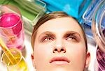 Close up of a young woman face surrounded by chemical glassware                                                                                                                                          Stock Photo - Premium Rights-Managed, Artist: ableimages               , Code: 822-02958531