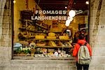 Tourist looking in Fromagerie shop window,Brussels,Belgium                                                                                                                                               Stock Photo - Premium Rights-Managed, Artist: Axiom Photographic       , Code: 851-02958809