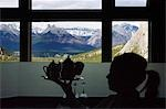 A silhouetted waitress at Banff Springs Hotel with views through to the Canadian Rockies,Banff National Park Alberta Canada                                                                              Stock Photo - Premium Rights-Managed, Artist: Axiom Photographic       , Code: 851-02958957