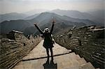 Tourist cheering on Great Wall of China,China                                                                                                                                                            Stock Photo - Premium Rights-Managed, Artist: Axiom Photographic       , Code: 851-02959091