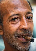 Man smoking cigar on streets,Havana,Cuba                                                                                                                                                                 Stock Photo - Premium Rights-Managednull, Code: 851-02959347