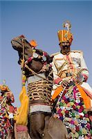 rajasthan camel - A soldier riding a camel at the Jaisalmer festival,Rajasthan,India                                                                                                                                       Stock Photo - Premium Rights-Managednull, Code: 851-02960461