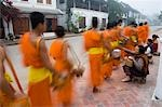 Novice monks out collecting alms at dawn,Luang Prabang,Northern Laos (UNESCO World Heritage Site)                                                                                                        Stock Photo - Premium Rights-Managed, Artist: Axiom Photographic       , Code: 851-02961355