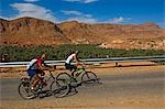 Cyclists along route of 1000 Kasbahs,Todra Valley,Tinerhir,Morocco                                                                                                                                       Stock Photo - Premium Rights-Managed, Artist: Axiom Photographic       , Code: 851-02962087