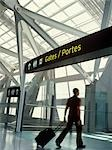 Man Entering Departure Gates, Pearson International Airport, Toronto, Ontario, Canada                                                                                                                    Stock Photo - Premium Rights-Managed, Artist: Damir Frkovic            , Code: 700-02967589