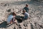 Children Burying Father in Sand Stock Photo - Premium Rights-Managed, Artist: oliv                     , Code: 700-02967884