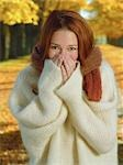 Portrait of Woman Wearing Sweater and Covering Mouth with Hands, Outdoors in Autumn                                                                                                                      Stock Photo - Premium Rights-Managed, Artist: Natasha Nicholson        , Code: 700-02972967