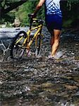 Backview of Cyclist Walking Bicycle Through Stream                                                                                                                                                       Stock Photo - Premium Rights-Managed, Artist: Natasha Nicholson        , Code: 700-02972968