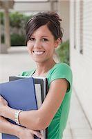 Portrait of University Student Holding Books Stock Photo - Premium Royalty-Freenull, Code: 600-02973163