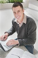University Student Using Laptop Computer Stock Photo - Premium Royalty-Freenull, Code: 600-02973194