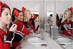 Cheerleaders putting on make up