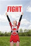 Cheerleader with fight sign Stock Photo - Premium Royalty-Free, Artist: Kablonk! RM, Code: 614-02984855