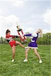 Cheerleaders fighting over trophy Stock Photo - Premium Royalty-Free, Artist: Andrew Kolb, Code: 614-02984866
