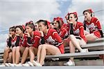 Cheerleaders on bleachers
