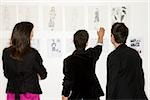 Fashion designers looking at designs Stock Photo - Premium Royalty-Free, Artist: Masterfile, Code: 614-02984944