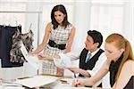 Fashion designers in meeting Stock Photo - Premium Royalty-Free, Artist: Aurora Photos, Code: 614-02984969