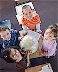 Children in Grade One Classroom Looking at Globe Stock Photo - Premium Rights-Managed, Artist: Horst Herget             , Code: 700-02989982