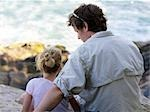 Father and Daughter Sitting Together on Rocks by the Ocean Stock Photo - Premium Rights-Managed, Artist: Natasha Nicholson        , Code: 700-02989988