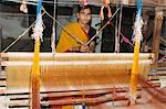 A woman weaving at one of the cooperatives in an area that is famous for its saris, Maheshwar, Madhya Pradesh state, India, Asia                                                                         Stock Photo - Premium Rights-Managed, Artist: Robert Harding Images, Code: 841-02992325
