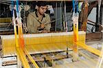 A man weaving at one of the cooperatives in an area that is famous for its saris, Maheshwar, Madhya Pradesh state, India, Asia                                                                           Stock Photo - Premium Rights-Managed, Artist: Robert Harding Images, Code: 841-02992328