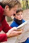 Father and son reading a map Stock Photo - Premium Royalty-Free, Artist: Cultura RM, Code: 679-02994921