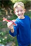 Boy playing with a toy aeroplane Stock Photo - Premium Royalty-Free, Artist: imagebroker, Code: 679-02994957