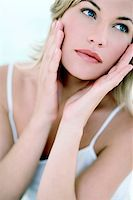Woman touching her face Stock Photo - Premium Royalty-Freenull, Code: 679-02995585