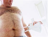 percentage symbol - Body fat assessment Stock Photo - Premium Royalty-Freenull, Code: 679-02996032