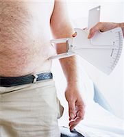 percentage symbol - Body fat assessment Stock Photo - Premium Royalty-Freenull, Code: 679-02996143