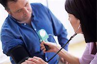 Blood pressure measurement Stock Photo - Premium Royalty-Freenull, Code: 679-02996194