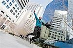 Excited Businessman Jumping in the Air Stock Photo - Premium Rights-Managed, Artist: Kevin Dodge              , Code: 700-03004048