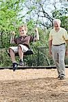 Grandfather Pushing Grandson on Swing Stock Photo - Premium Rights-Managed, Artist: Kevin Dodge              , Code: 700-03004053