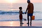 Grandfather and Grandson on the Beach with a Net and Bucket Stock Photo - Premium Rights-Managed, Artist: Kevin Dodge              , Code: 700-03004055
