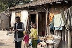 Family Outside their Home, Tilijara, Kolkata, West Bengal, India Stock Photo - Premium Rights-Managed, Artist: Sarah Murray             , Code: 700-03004179