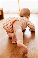 Baby Crawling on Floor Stock Photo - Premium Royalty-Freenull, Code: 600-03004406