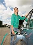 Woman at petrol pump Stock Photo - Premium Royalty-Free, Artist: Transtock, Code: 649-03008448