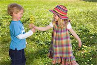 girl giving spring flower bouquet to boy Stock Photo - Premium Royalty-Freenull, Code: 649-03009348
