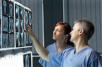 Two doctors looking at x-rays Stock Photo - Premium Royalty-Freenull, Code: 649-03009999