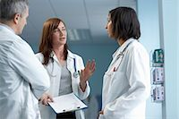 3 doctors in discussion Stock Photo - Premium Royalty-Freenull, Code: 649-03010013