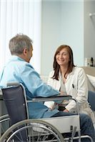 Doctor with patient in wheelchair Stock Photo - Premium Royalty-Freenull, Code: 649-03010024