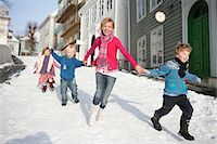 Scandinavian children running in snow Stock Photo - Premium Royalty-Freenull, Code: 649-03010042