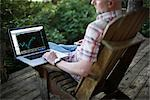 Man Using a Laptop Computer at the Cottage                                                                                                                                                               Stock Photo - Premium Rights-Managed, Artist: Ron Fehling              , Code: 700-03014796