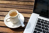 Laptop Computer and a Cup of Coffee                                                                                                                                                                      Stock Photo - Premium Rights-Managednull, Code: 700-03014803