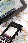 Close-up of Text Message, GPS Device, and Road Map Stock Photo - Premium Rights-Managed, Artist: Uwe Alexander Kirsten    , Code: 700-03017007