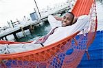 Businessman Lying in Hammock Stock Photo - Premium Rights-Managed, Artist: Kevin Dodge              , Code: 700-03017578